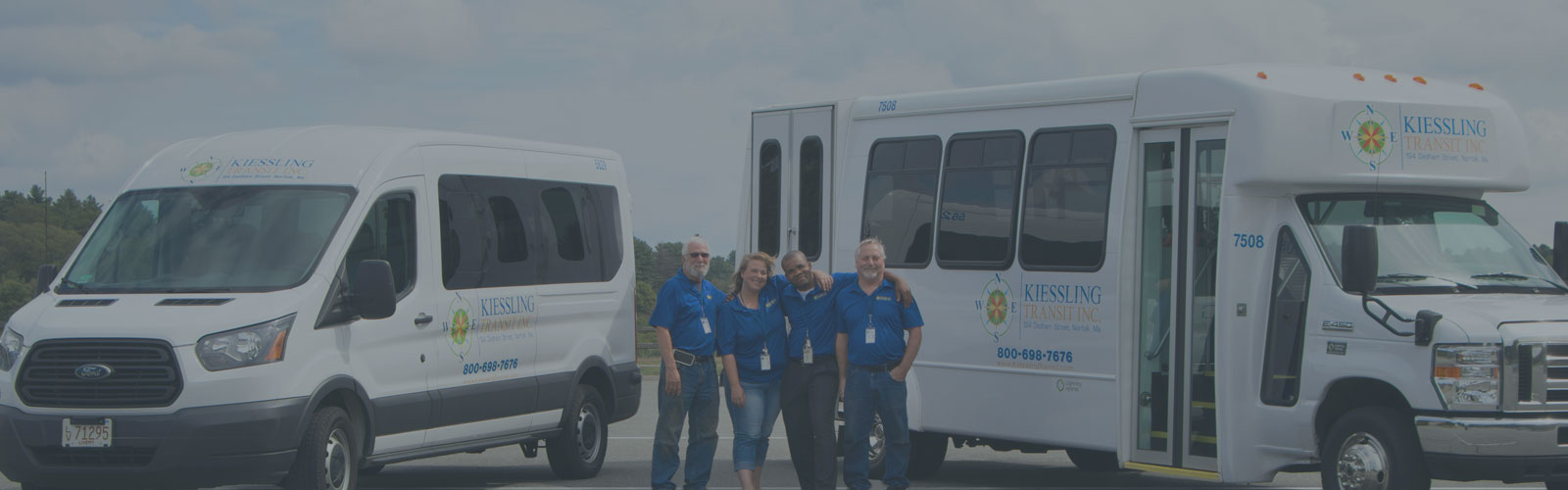 Kiessling Transit Operations Team Standing in Front of KTI Vehicles - About Us Title Background